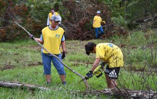 Carol Reilly and Jackson McCreless from the Tallahassee Florida Stake work on debris removal.
